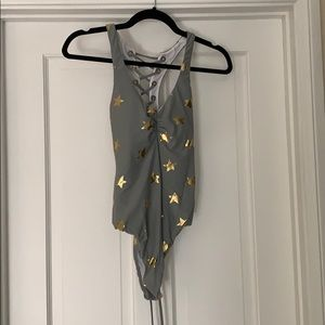 Grey bathing suit with gold stars
